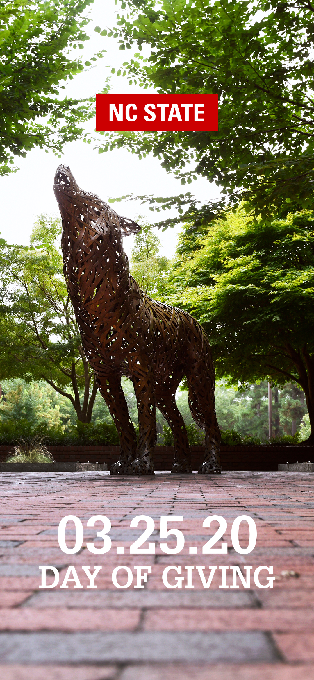 Picture of the howling Iron Wolf statue with text overlaid reading NC State Day of Giving 03.25.20
